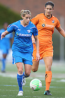 Yael Averbuch tries to stop Kelly Smith from breaking away.