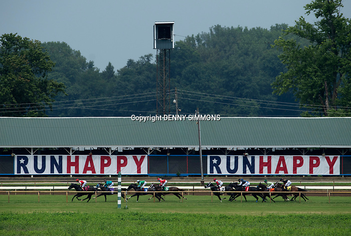 Horses and riders compete in the third race at Ellis Park in Henderson, Ky., Sunday afternoon, Aug. 9, 2020. The race is a qualifier for the upcoming Sept. 5, 2020, Kentucky Derby, with 85 points (50-20-10-5) up for grabs.