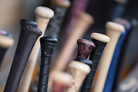 Baseball bats sit in the bat rack in the Lehigh Valley Iron Pigs dugout during the game against the Charlotte Knights at BB&T BallPark on June 3, 2016 in Charlotte, North Carolina.  The Iron Pigs defeated the Knights 6-4.  (Brian Westerholt/Four Seam Images)