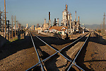 Oil Refinery and Railroad Tracks towards downtown Denver, Commerce City, Colorado. .  John offers private photo tours in Denver, Boulder and throughout Colorado. Year-round Colorado photo tours.
