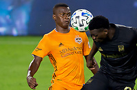 CARSON, CA - OCTOBER 28: Darwin Quintero #23 of the Houston Dynamo with his eyes on the ball during a game between Houston Dynamo and Los Angeles FC at Banc of California Stadium on October 28, 2020 in Carson, California.