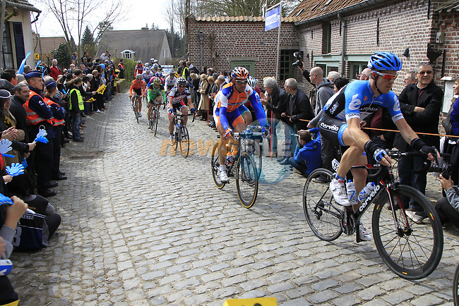 The breakaway group including Tyler Farrar (USA) Garmin-Barracuda, Maarten Tjallingii (NED) Rabobank and Gert Dockx (BEL) Lotto-Belisol climb Molenberg during the 96th edition of The Tour of Flanders 2012, running 256.9km from Bruges to Oudenaarde, Belgium. 1st April 2012. <br /> (Photo by Eoin Clarke/NEWSFILE).