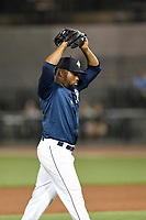 Pitcher Adonis Uceta (30) of the Columbia Fireflies raises his hands after the final strike in a game against the Charleston RiverDogs on Friday, June 9, 2017, at Spirit Communications Park in Columbia, South Carolina. Columbia won, 3-1. (Tom Priddy/Four Seam Images)