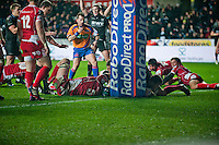 Friday 03 January 2014<br /> Pictured: Ashley Beck  scores behind the post for the Osprays<br /> Re: Osprays v Scarlets, Rabo Direct Pro 12 match at the Liberty Stadium Swansea, Wales