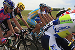 The peloton including Chris Froome (GBR) Sky Procycling pass through flat farmland near the village of Limont during Stage 2 of the 99th edition of the Tour de France 2012, running 207.5km from Vise to Tournai, Belgium. 2nd July 2012.<br /> (Photo by Eoin Clarke/NEWSFILE)