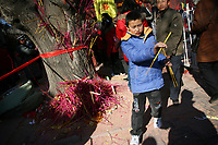 CHINA. A young boy during Chinese New Year in Baiyun Temple in Beijing.  Chinese New Year, or Spring Festival, is the most important festival and holiday in the Chinese calendar In mainland China, many people use this holiday to visit family and friends and also visit local temples to offer prayers to their ancestors. The roots of Chinese New Year lie in combined influences from Buddhism, Taoism, Confucianism, and folk religions.  2008