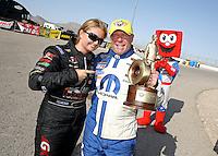 Apr. 7, 2013; Las Vegas, NV, USA: NHRA pro stock runner-up Erica Enders-Stevens (left) congratulates Allen Johnson who celebrates after winning the Summitracing.com Nationals at the Strip at Las Vegas Motor Speedway. Mandatory Credit: Mark J. Rebilas-