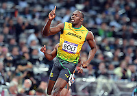 August 05, 2012..Usain Bolt points towards the sky after winning Men's 100m sprint by setting a new Olympic record on day nine of 2012 Olympic Games in London, United Kingdom.