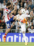 Real Madrid's Sergio Ramos (r) and Atletico de Madrid's Arda Turan during Champions League 2014/2015 Quarter-finals 2nd leg match.April 22,2015. (ALTERPHOTOS/Acero)
