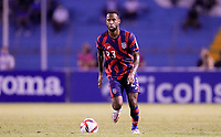 SAN PEDRO SULA, HONDURAS - SEPTEMBER 8: Kellyn Acosta #23 of the United States looks for an open man downfield during a game between Honduras and USMNT at Estadio Olímpico Metropolitano on September 8, 2021 in San Pedro Sula, Honduras.