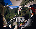 Interior of a Bell Jet Ranger Helicopter flying at low level through native forest near Waikaremoana. North Island New Zealand.