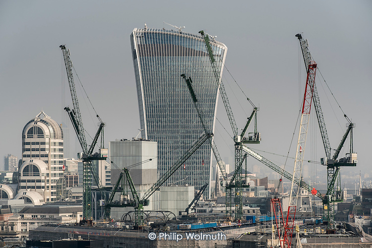 City of London landmark Walkie-Talkie building and cranes.