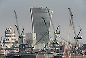 City of London landmark Walkie-Talkie building and cranes.