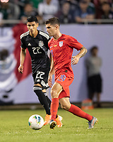 CHICAGO, IL - JULY 7: Christian Pulisic #10 passes the ball with Uriel Antuna #22 during a game between Mexico and USMNT at Soldiers Field on July 7, 2019 in Chicago, Illinois.