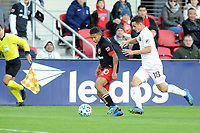 WASHINGTON, DC - MARCH 07: Edison Flores #10 of D.C. United battles the ball with Dylan Nealis #18 of Inter Miami CF during a game between Inter Miami CF and D.C. United at Audi Field on March 07, 2020 in Washington, DC.