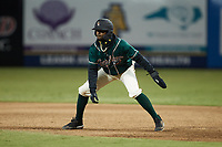Liover Peguero (10) of the Greensboro Grasshoppers takes his lead off of first base against the Hickory Crawdads at First National Bank Field on May 6, 2021 in Greensboro, North Carolina. (Brian Westerholt/Four Seam Images)