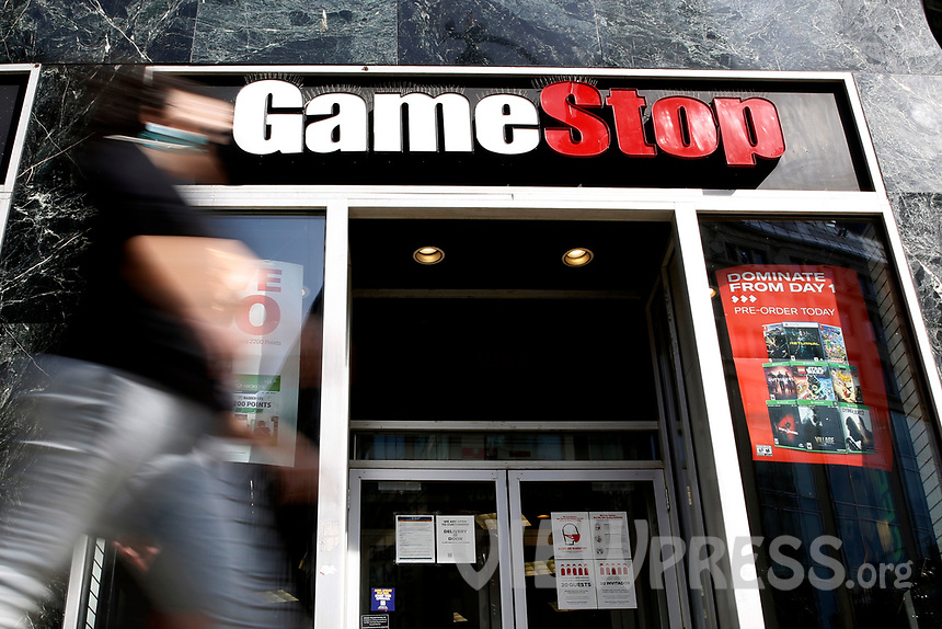 NEW YORK - NEW YORK - MARCH 23: A man passes by GameStop at 6th Avenue on March 23, 2021 in New York. GameStop stocks falls more than 10% after the video game store showing  strong earnings but lower than expected. (Photo by John Smith/VIEWpress)