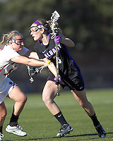 University at Albany attacker Taylor Frink (3) on the attack as Boston College midfielder Jessie Coffield (15) defends. University at Albany defeated Boston College, 11-10, at Newton Campus Field, on March 30, 2011.