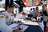 #7 Acura Team Penske Acura DPi, P: Helio Castroneves, Ricky Taylor signs an autograph for a fan in the paddock