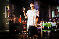 A Chinese young waves to the camera in Shenyang, China, August 2008...Photo by Roberto Candia