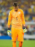 Fernando Muslera of Uruguay looks dejected