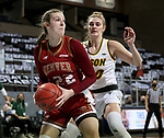 SIOUX FALLS, SD - MARCH 7: Sam Deem #22 of the Denver Pioneers looks for help while being guarded by Emily Behnke #20 of the North Dakota State Bison during the Summit League Basketball Tournament at the Sanford Pentagon in Sioux Falls, SD. (Photo by Dave Eggen/Inertia)