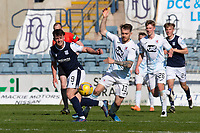 24th April 2021; Dens Park, Dundee, Scotland; Scottish Championship Football, Dundee FC versus Raith Rovers; Brad Spencer of Raith Rovers challenges for the ball with Danny Mullen of Dundee
