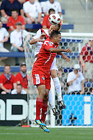 Kevin McKenna (white ) defender Canada goes up for a header with Eybir Bonaga Panama...Canada and Panama tied 1-1 in Gold Cup play at LIVESTRONG Sporting Park, Kansas City, Kansas.