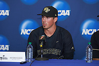 Parker Dunshee (36) of the Wake Forest Demon Deacons answers questions following the game against the Florida Gators in Game Three of the Gainesville Super Regional of the 2017 College World Series at Alfred McKethan Stadium at Perry Field on June 12, 2017 in Gainesville, Florida. The Gators defeated the Demon Deacons 3-0 to advance to the College World Series in Omaha, Nebraska. (Brian Westerholt/Four Seam Images)