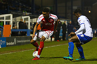 Fleetwood Town's Victor Nirennold (left) in action with Bury's Greg Leigh (right) during the The Checkatrade Trophy match between Bury and Fleetwood Town at Gigg Lane, Bury, England on 9 January 2018. Photo by Juel Miah/PRiME Media Images.
