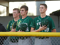 Venice Indians Aidan Beechy (26) and Hunter Possehl (28) during the national anthem before a game against the Braden River Pirates on February 25, 2021 at Braden River High School in Bradenton, Florida.  (Mike Janes/Four Seam Images)
