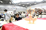"May 3, 2010 - Tokyo, Japan - A PVC Figurine is on display during the Treasure Festa 2010 at Tokyo Big Sight, Japan, on May 4, 2010. Some visitors and hobbyists concentrate specifically on a certain type of figure, such as garage kits, gashapon, or PVC bishojo (pretty girl) statues. According to many who study the phenomenon, many 'figure moe zoku', a Japanese term which refers to ""Otaku who collect figurines"", have difficulty in navigating modern romantic life and prefer to go on ""dates"" with their favorite figurine during off hours."