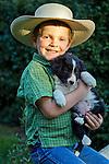 Little cowpoke with his puppy, San Luis Obispo, California