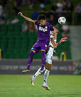 27th March 2021; HBF Park, Perth, Western Australia, Australia; A League Football, Perth Glory versus Newcastle Jets; Liridon Krasniqi of the Newcastle Jets wins the header against Kosuke Ota of Perth Glory