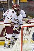 Brian Dumoulin (BC - 2), Brian Gibbons (BC - 17), Edwin Shea (BC - 8) celebrate Ben Smith's shorthanded GWG. - The Boston College Eagles defeated the Merrimack College Warriors 4-3 on Friday, October 30, 2009, at Conte Forum in Chestnut Hill, Massachusetts.
