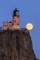"""""""To the Edge""""<br /> <br /> The December (near) full Cold Moon rose through near Split Rock Lighthouse on the eve of the Supermoon. When near the edge of the cliff, it appeared as if it could simply roll down into the lake."""
