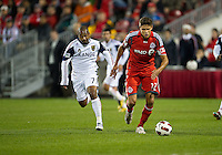 28 September 2010: Real Salt Lake midfielder Andy Williams #77 and Toronto FC defender Adrian Cann #12 in action during a CONCACAF Champions League game between Real Salt Lake and Toronto FC at BMO Field in Toronto..Final score was 1-1...