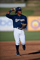 AZL Brewers Blue second baseman Orveo Saint (30) jogs off the field between innings of an Arizona League game against the AZL Athletics Gold on July 2, 2019 at American Family Fields of Phoenix in Phoenix, Arizona. AZL Athletics Gold defeated the AZL Brewers Blue 11-8. (Zachary Lucy/Four Seam Images)