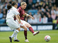 Arsenal vs Leeds United - Womens FA Cup Final at Millwall Football Club - 01/05/06 - Arsenal's Kelly Smith threads the ball past Nicole Emmanuel - (Gavin Ellis 2006)