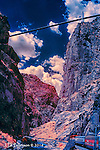 Bridge over Royal Gorge Railroad, Colorado (Infrared) ©2016 James D Peterson.  This scenic railroad was formerly a route on the Santa Fe line.  The tracks follow the Arkansas River through this dramatic canyon.  My lens was just barely wide enough to capture both the train and the bridge.