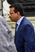 Pictured: Khitish Mohanty (right) arrives at Cardiff Crown Court, Cardiff, Wales, UK. Monday 07 October 2019<br /> Re: Orthopaedic surgeon Khitish Mohanty, has been cleared of two sex offence charges involving a patient at a private hospital, by a jury at Cardiff Crown Court, Wales, UK. (02 Nov 2020)<br /> Mohanty, 52, denied attacking a 20-year-old when he was examining her at Bupa hospital in Cardiff, after a serious car crash in 2005.<br /> A jury was told a criminal investigation started in 2017 after the complainant, now in her mid-30s, contacted police.