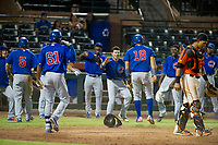 AZL Cubs first baseman Luis Hidalgo (18) celebrates with Yonathan Perlaza (15), Carlos Sepulveda (16), and Alfredo Colorado (75) after scoring a run against the AZL Giants on September 5, 2017 at Scottsdale Stadium in Scottsdale, Arizona. AZL Cubs defeated the AZL Giants 10-4 to take a 1-0 lead in the Arizona League Championship Series. (Zachary Lucy/Four Seam Images)