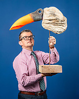 BNPS.co.uk (01202 558833)<br /> Pic: MaxWillcock/BNPS<br /> <br /> Pictured: Associate Director and 20th Century Design Specialist Michael Jeffery of Woolley & Wallis with 'Jabiru', a driftwood sculpture featuring a fluorescent orange plastic buoy, created by artist Sid Bunard in 2013.<br /> <br /> Twelve eye-catching driftwood sculptures by one of Britain's most eccentric artists have emerged for sale.<br /> <br /> Brighton-born Sid Burnard uses objects washed up on beaches to fashion unusual artworks of humans and animals.<br /> <br /> They are going under the hammer with auctioneers Woolley & Wallis where they could sell for a combined £4,000.<br /> <br /> The collection includes an impressive Jabiru bird whose beak is made out of a fragment of an orange buoy.