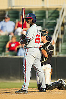 Felix Marte (28) of the Rome Braves checks the sign with his third base coach during the South Atlantic League game against the Kannapolis Intimidators at CMC-Northeast Stadium on August 25, 2013 in Kannapolis, North Carolina.  The Intimidators defeated the Braves 9-0.  (Brian Westerholt/Four Seam Images)