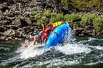 White water raft flips  on the Lower Salmon River, central Idaho