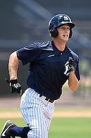 GCL Yankees 2 shortstop Tyler Palmer (31) runs to first during a game against the GCL Braves on June 23, 2014 at the Yankees Minor League Complex in Tampa, Florida.  GCL Yankees 2 defeated the GCL Braves 12-4.  (Mike Janes/Four Seam Images)