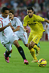 Villarreal player Mario (R) advances with the ball during the match between Sevilla FC and Villarreal day 9 spanish  BBVA League 2014-2015 day 5, played at Sanchez Pizjuan stadium in Seville, Spain. (PHOTO: CARLOS BOUZA / BOUZA PRESS / ALTER PHOTOS)