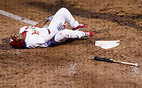 Oscar Taveras (25) of the Springfield Cardinals lays on the ground in pain after being hit by a pitch during a game against the Arkansas Travelers at Hammons Field on July 25, 2012 in Springfield, Missouri. (David Welker/Four Seam Images)