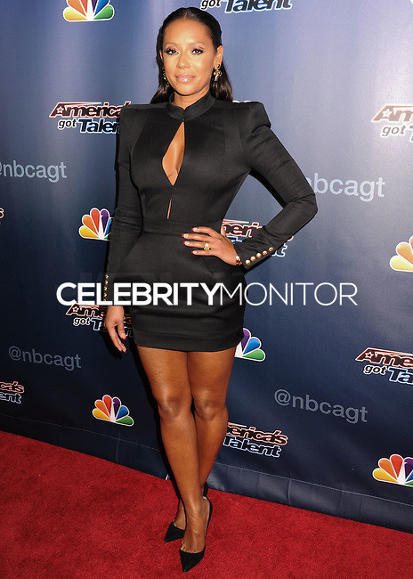 NEW YORK CITY, NY, USA - AUGUST 20: Mel B, Melanie Brown arrives at the 'America's Got Talent' Post Show Red Carpet held at Radio City Music Hall on August 20, 2014 in New York City, New York, United States. (Photo by Celebrity Monitor)