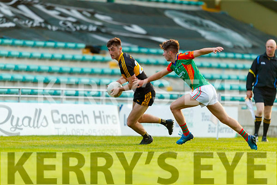 David Shaw, Dr. Crokes in action against David Mangan, Mid Kerry during the Kerry County Senior Football Championship Semi-Final match between Mid Kerry and Dr Crokes at Austin Stack Park in Tralee, Kerry.